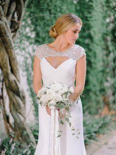 Beautiful bride in Justin Alexander dress. White roses flower arrangement. www.pashabelman.com - Brookgreen Garden Wedding Photography by Pasha Belman