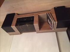 Cardboard Audio furniture made of cardboard layers and wood finish