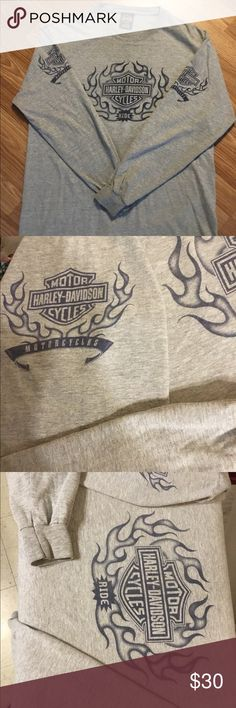 Authentic Harley-Davidson Long Sleeved Tee Beautiful Authentic Harley-Davidson Long Sleeved Gray Tee. Blue on Gray Print on sleeves and Front. EUC. Back Has a great pic of The Woodlands Texas Harley Davidson. Size L Harley-Davidson Shirts Tees - Long Sleeve