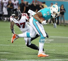 News Photo : Miami running back Arian Foster scores a...