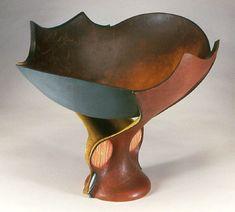 Cuir bouilli bowls by leather artist Rex Lingwood.
