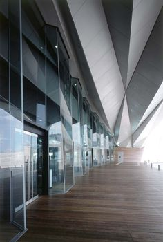 Faceted glasses to reduce wind impact, metalic structure same technique as ships: Yokohama International Passenger Terminal / Foreign Office Architects (FOA)