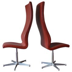 Set of Two Tall Leather Oxford Chairs by Arne Jacobsen for Fritz Hansen circa 1970 | From a unique collection of antique and modern swivel chairs at https://www.1stdibs.com/furniture/seating/swivel-chairs/