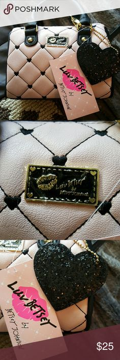 Betsy Johnson small purse Punk and black. Great for valentines gift . Black heart attached. Brand new. Has,removable shoulder strap.  7 inches long.5 inches tall. Brand new Betsey Johnson Bags Mini Bags