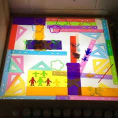 The addition of triangles and rulers has lead to some interesting design and problem solving at our light table.