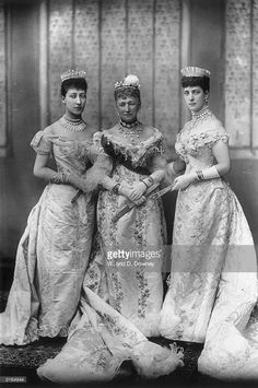 1893: Queen Louise of Denmark, (1817 - 1898), centre, with her daughter Princess Alexandra (1844 - 1925) consort of Edward VII, and granddaughter Lady Alexandra Duff, Duchess of Fife (1867 - 1931), on the occasion of George V's wedding. Duke of York, later King George V (1865 - 1936) and Princess Mary of Teck (1867 - 1953).