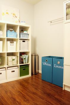 I want this laundry room... especially the labeled hampers!