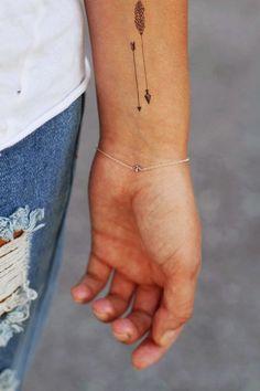 Simple Arrow Tattoo On Wrist