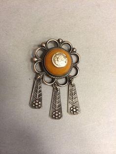 Latvian amber brooch.