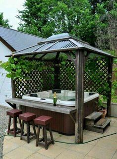 Hot tub cover provides you an ultimate relaxing time while enjoying the natural surrounding in your backyard. Find some amazing hot tub enclosure ideas here! tub gazebo ideas Most Mesmerizing and Super Cozy Hot Tub Cover Ideas Hot Tub Gazebo, Hot Tub Deck, Hot Tub Backyard, Backyard Patio, Backyard Landscaping, Backyard Ideas, Hot Tub Bar, Hot Tub Garden, Jacuzzi Patio Ideas