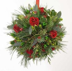 Have you ever seen a Christmas kissing ball? These decorated balls of evergreens, holly and herbs hang over doorways during the Christma. Ball Decorations, Christmas Decorations, Christmas Ornaments, Christmas Makes, Christmas Holidays, Christmas Recipes, Christmas Ideas, Merry Christmas, Advent