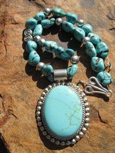 Sterling Silver Turquoise Medallion Necklace by fleurdesignz.etsy.com