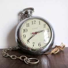 Pocket Watch Wall Clock. I want this.  It looks just like my grandfather's.