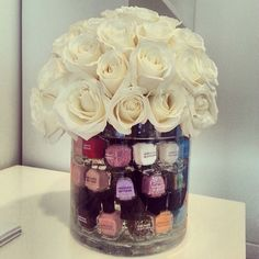 Spa party centerpiece idea (Flowers topping nail polish in vase)
