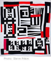 Red and black Gee's Bend quilt.