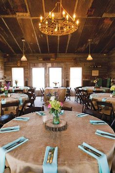 Love the burlap table cloth paired with aqua napkins. Also love a chandelier in a rustic barn