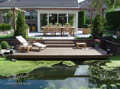 Garden with lots of decking to a ditch.