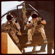 US Navy SEALs fast roping out of a US Army 160th SOAR Little Bird helo.