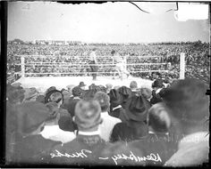 Jack Dempsey and Billy Miske boxing in a boxing ring during a bout in Benton Harborc - 1920
