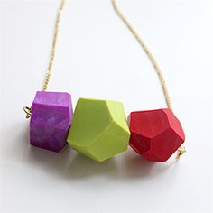Make a statement with this colorful and bright Geometric Necklace.