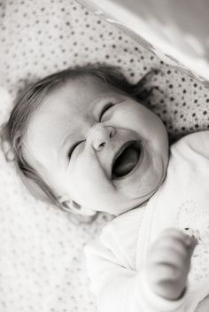 laughter...Adorable .. makes a mama's heart just melt ! Can't you just almost heat that deep little belly laugh? :)