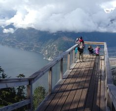 A woman and young children pause at a viewing platform along the Panorama Trail reached via the Sea to Sky Gondola near Squamish, B.C. Trails at the top are gentle enough for almost everyone, with dazzling views of Howe Sound and mountains. (Kristin Jackson / The Seattle Times)