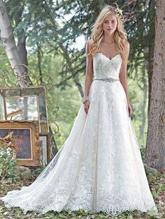 Maggie Sottero - LUNA, Dreamy lace and tulle combine to create this princess ball gown wedding dress, with a romantic sweetheart neckline, and delicate Swarovski crystal belt accenting the waist. Finished with crystal buttons over zipper and inner corset closure.