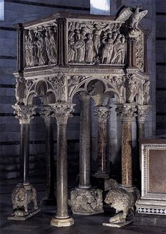 """Nicola Pisano's Pulpit at Pisa (16-31, pg 522)  Located in Pisa Baptistery in Italy free standing Created in the year 1260 out of marble  He inscribed on it """"In the year 1260 Nicola Pisano carved this nobble work. May so a gifted hand be praised as it deserves."""" Each panel  illustrates scenes in a continuous narrative Columns topped with leafy Corinthian capitals support standing figures and rest on high bases carved with many figures (See page 523 for more info) ; Gothic trefoil arches MO"""