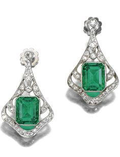 PAIR OF EMERALD AND DIAMOND EARRINGS, EARLY 20TH CENTURY Of open work kite design, millegrain-, collet-set with a step-cut emerald within similarly set surrounds of circular- and single-cut diamonds, later screw back fittings.