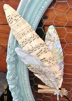love these old map and sheet music paper feathers