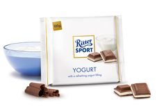 Yogurt. made of live skimmed-milk yogurt in firm milk chocolate