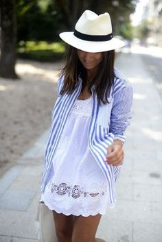Blue and white striped shirt over pretty white lace dress with cute white hat.