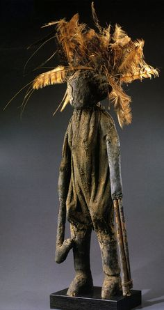 Africa | Kafigueledio statuette from the Senufo people of the Ivory Coast | Wood, feathers, natural fibers