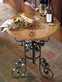 Handcrafted from the lid of an authentic French oak barrel used to ferment fine wine, our Reclaimed Wine Barrel Tasting Table retains the distinct character of its original cask and is sure to be a conversation piece at your next wine tasting.