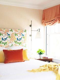 Caccoma Interiors - bedrooms - tan, grasscloth, wallpaper, orange, blue, birds, fabric, headboard, orange, yellow, pillows, yellow, throw, orange, roman shade,