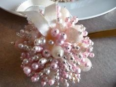 To make these ornaments, we took apart some faux pearl necklaces, re-strung the beads on dressmaker pins and then inserted the pins into by marian