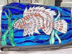 Items similar to Lion Fish on Rock on Etsy Mosaic Crafts, Mosaic Art, Mosaic Glass, Stained Glass, Glass Art, Painted Pebbles, Hand Painted, Painted Stones, Mosaic Designs