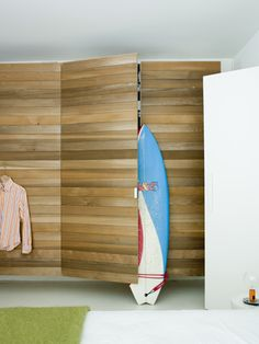 wood wall | The grain of the wood serves as a disguise for the closet door