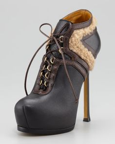 How about a Tribtoo Fur-Trim Ankle Bootie by Yves Saint Laurent for a brisk Fall day. And do not forget your shearling vest. I like!