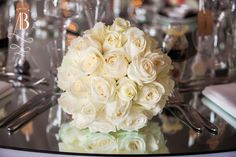 Pure elegance of a stunning white roses bridal bouquet dressed with diamonds and pearls to compliment the Brides beautiful dress