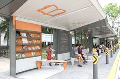 Singapore May Have Designed the World's Best Bus Stop An architecture firm and the government collaborated on a bus stop with books, a rooftop garden, and a swing. Lake District, Ottawa, Bus Stop Design, Bus Shelters, Public Space Design, Shelter Design, Urban Furniture, Furniture Market, Furniture Outlet