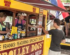 Trolley Dogs Food Truck serving customers at the Charles River Food Truck Festival in DCR's Aresani Herter Park. #FTFNE #NEFoodTrucks