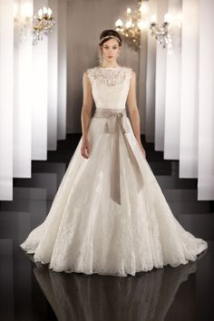 Gorgeous lace. Neckline is a little high though. - Martina Liana Wedding Dresses Photos on WeddingWire
