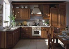 https://www.maxkuchnie.pl/galeria/kuchnia-otwarta/ Kuchnia dla miłośników klasycznych rozwiązań. Drewniane meble w połączeniu z jasnymi dodatkami.