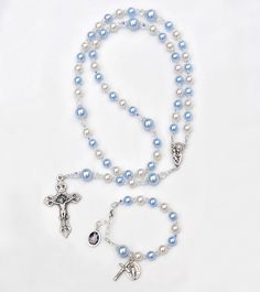 Personalized Baby Boy Baptism Rosary Gift Set - Matching Guardian Angel Baby Bracelet - Blue and White Swarovski Pearls - With Prayer Book by RosariesOfLove on Etsy https://www.etsy.com/listing/207375865/personalized-baby-boy-baptism-rosary