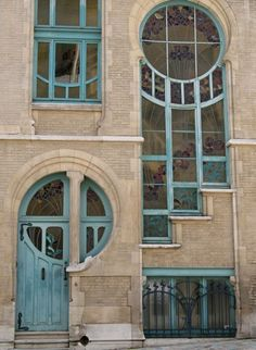 Art Nouveau or Deco with stained glass windows - love the facade of this building