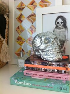 layering books/skull with frames