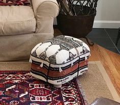 Handmade footstool artfully upholstered with vintage tribal blanket from Mali.