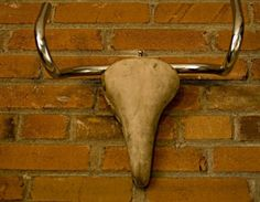 This hommage to Picassos Toro uses vintage leather bike seat and handle bars to artistically recreate a Rams skull. Truly Unique