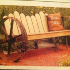 Wooden bench on old wagon wheels